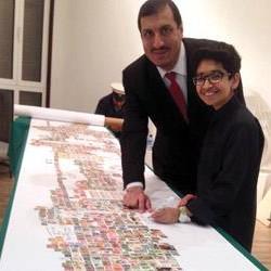 """سعودي يدخل """"غينيس"""" بأطول لوحة طوابع بريدية في العالم"""